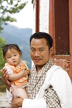 Bhutanese man with daughter, Jankar, Bumthang, Bhutan, Asia