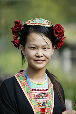 Young woman of Yao Minority mountain tribe in traditional costume, Li River, Yangshuo, Guangxi Province, China, Asia