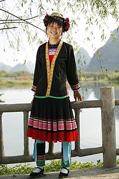 Young woman of Yao Minority mountain tribe, with traditional costume, Li River, Yangshuo, Guangxi Province, China, Asia