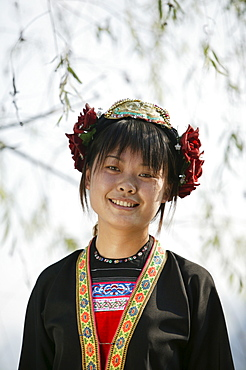 Young woman of Yao Minority mountain tribe, with traditional costume, Li River, Yangshuo, Guangxi Province, China, Asia
