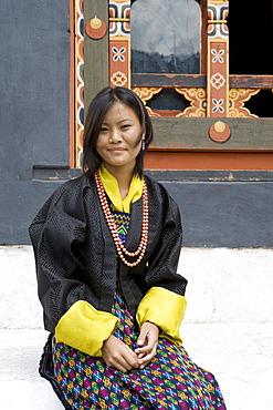 Bhutanese woman in typical dress at Buddhist festival (Tsechu), Trashi Chhoe Dzong, Thimphu, Bhutan, Asia