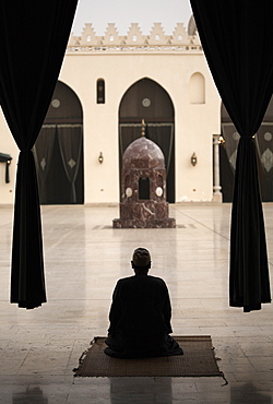 Man praying at the Mosque of Al-Hakim, Cairo, Egypt, North Africa, Africa