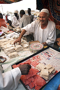 Sudanese sweets are sold at a festival celebrating the Prophet's birthday, Shendi, Sudan, Africa
