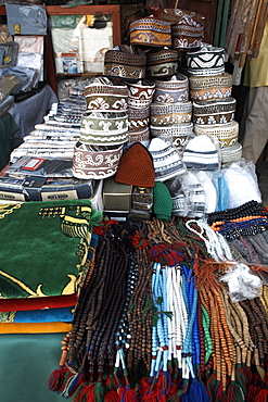 Islamic items including prayer mats and Muslim caps on sale at the market in the European Quarter of Djibouti City, Djibouti, Africa