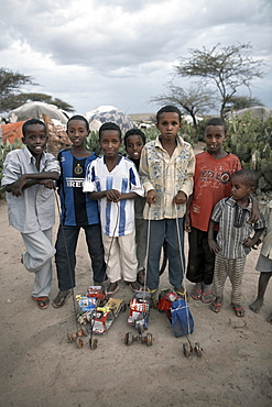 Children with home-made toys pose for a photograph in an Internally Displaced Persons camp in the city of Hargeisa, capital of Somaliland, Somalia, Africa