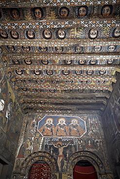 Some of Ethiopia's finest ecclesiastical artwork adorns the walls of Debre Berhan Selassie Church, Gondar, Ethiopia, Africa
