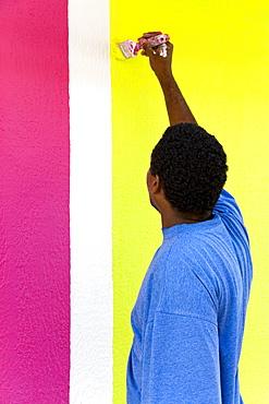 Painting a shop on Republique Street, Fort-de-France, Martinique, French Antilles, West Indies, Caribbean, Central America