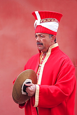 Traditional Turkish musician, Istanbul, Turkey, Europeboosted reds with curves, softened red shadows