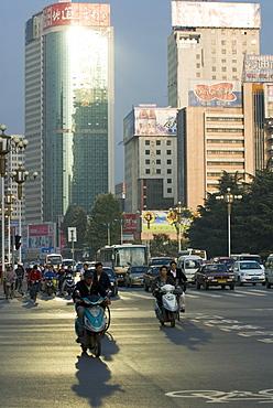 Early morning traffic, Kunming, Yunnan, China, Asia