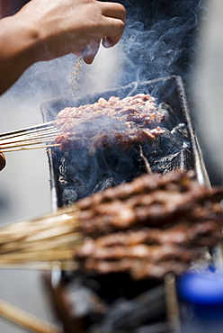 Adding spice to the barbeque, Kunming, Yunnan, China, Asia