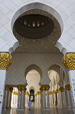 Arches and columns of the courtyard of the new Sheikh Zayed Bin Sultan Al Nahyan Mosque, Grand Mosque, lone figure, Abu Dhabi, United Arab Emirates, Middle East
