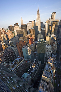 Wide angle view of the city skyline including the Chrysler Building and Empire State Building from the UN Plaza Hotel, early morning, Manhattan, New York, United States of America, North America