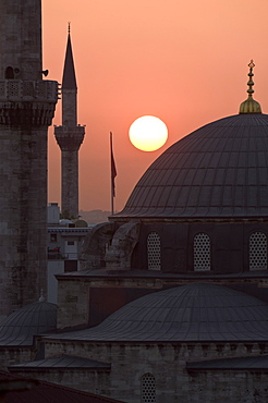 Sun setting behind Mahamut Pasha Mosque, Istanbul, Turkey, Europe