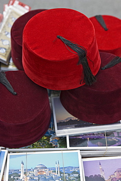 Traditional Turkish fezes and postcards for sale, Istanbul, Turkey, Europe