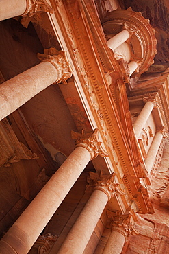 Looking up at the facade of the Treasury (Al Khazneh) carved into the red rock, Petra, UNESCO World Heritage Site, Jordan, Middle East