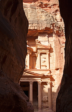 The facade of the Treasury (Al Khazneh) carved into the red rock, seen from the Siq, Petra, UNESCO World Heritage Site, Jordan, Middle East