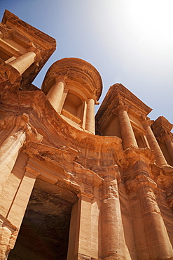The facade of the Monastery carved into the red rock at Petra, UNESCO World Heritage Site, Jordan, Middle East
