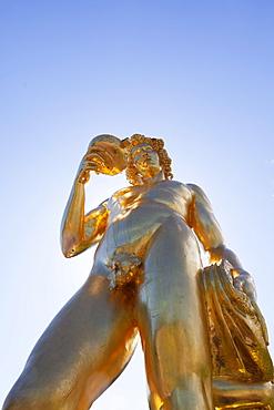 Golden statue on the Grand Cascade at Peterhof Palace, St. Petersburg, Russia, Europe