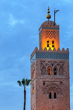 The Minaret of the Koutoubia Mosque, illuminated at dusk with single palm tree, UNESCO World Heritage Site, Marrakech, Morocco, North Africa, Africa