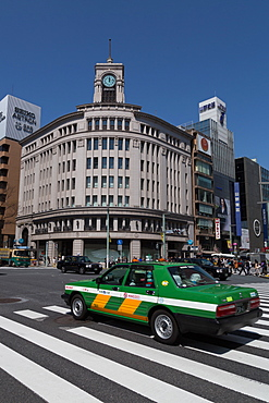 Taxi passing Wako department store in the Ginza district of Tokyo, Japan, Asia