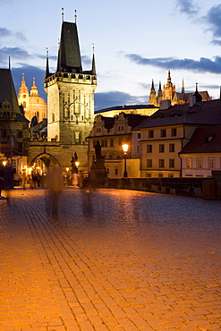 Little Quarter Bridge Tower, with St. Vitus's Cathedral, in the distance, taken from Charles Bridge, Little Quarter, in the evening, Prague, Czech Republic, Europe