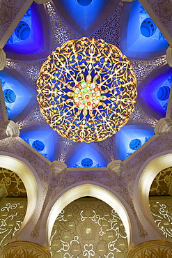 The largest ornate chandelier in the world hanging from the main dome inside the prayer hall of Sheikh Zayed Bin Sultan Al Nahyan Mosque, Abu Dhabi, United Arab Emirates, Middle East