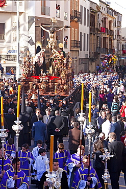 Religious float being carried through the streets during Semana Santa (Holy Week) celebrations, Malaga, Andalucia, Spain, Europe