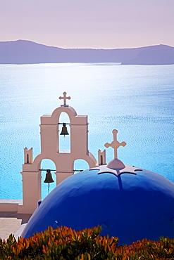 Bell Tower of Orthodox Church overlooking the Caldera in Fira, Santorini (Thira), Cyclades Islands, Aegean Sea, Greek Islands, Greece, Europe