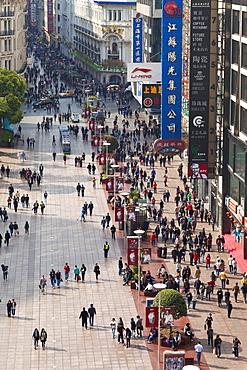 Pedestrians walking past stores on Nanjing Road, Shanghai, China, Asia