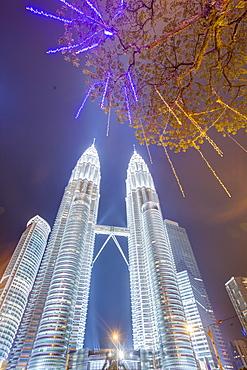 Low angle view of the Petronas Twin Towers, Kuala Lumpur, Malaysia, Southeast Asia, Asia