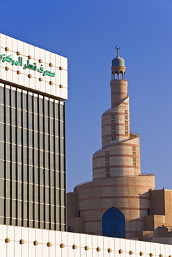 Qatar Central Bank and the spiral mosque of the Kassem Darwish Fakhroo Islamic Centre in Doha based on the Great Mosque in Samarra in Iraq, Doha, Qatar, Middle East