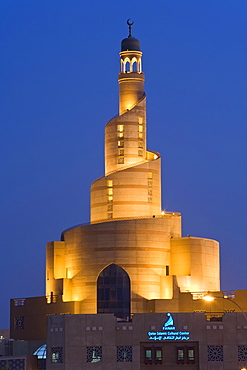 The illuminated spiral mosque of the Kassem Darwish Fakhroo Islamic Centre in Doha based on the Great Mosque of Al-Mutawwakil in Samarra in Iraq, Doha, Qatar, Middle East