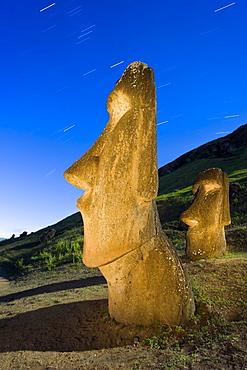 Maoi statues at Rano Raraku, illuminated at dusk, Easter Island (Rapa Nui), UNESCO World Heritage Site, Chile, South America