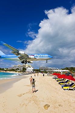 Beach at Maho Bay and low flying aircraft approaching the runway of Princess Juliana International airport, St. Martin (St. Maarten), Leeward Islands, West Indies, Caribbean, Central America
