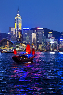 View from Kowloon of one of the last remaining Chinese sailing junks on Victoria Harbour, Hong Kong, China, Asia