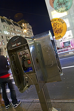 Pay phone and shop windows on Fifth Avenue at night, Manhattan, New York City, New York, United States of America, North America