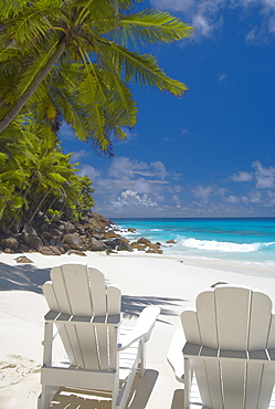 Two Adirondack chairs on tropical beach, Seychelles, Indian Ocean, Africa