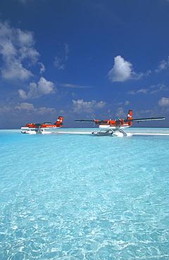 Maldivian air taxi seaplanes parked on sandbank, Maldives, Indian Ocean, Asia