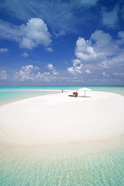 Woman walking on a sandbank, Maldives, Indian Ocean, Asia