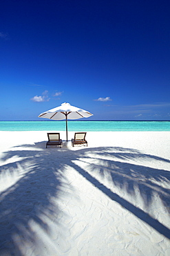 Deck chairs and tropical beach, Maldives, Indian Ocean, Asia