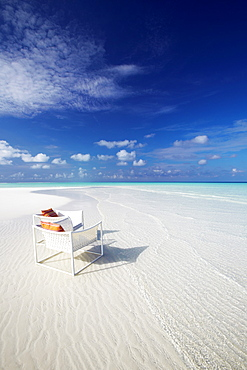 Deck chairs on tropical beach, Maldives, Indian Ocean, Asia