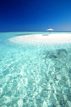 Tropical sandbank and sun umbrella, Maldives, Indian Ocean, Asia