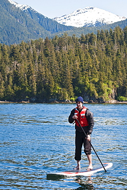 Paddleboarding in Windham Bay in the Chuck River Wilderness Area, Southeast Alaska, United States of America, North America