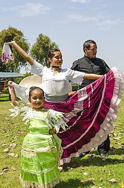 A Marinera dancer dancing a typical Peruvian dance in Trujillo, Peru, South America