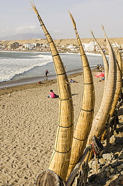 Caballitos de totora or reed boats on the beach in Huanchaco, Peru, South America
