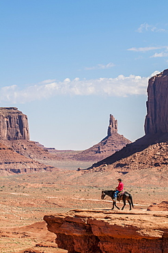 Navajo man on horseback, Monument Valley Navajo Tribal Park, Monument Valley, Utah, United States of America, North America