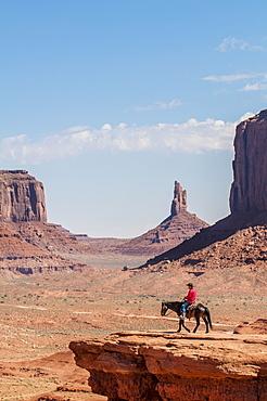 Navajo man on horseback, Monument Valley Navajo Tribal Park, Monument Valley, Utah, United States of America, North America
