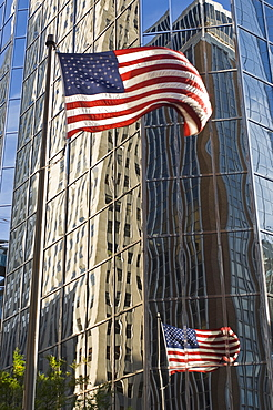 Building reflections and American flag, Oklahoma City, Oklahoma, United States of America, North America