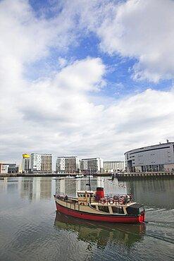 Ireland, North, Belfast, Titanic Quarter, tour boat taking tourists on sightseeing cruise.