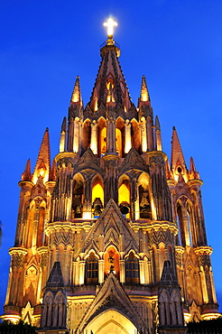 Mexico, Bajio, San Miguel de Allende, La Parroquia church neo-gothic exterior illuminated at night.